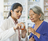 Image of Pharmacist consulting with patient in pharmacy